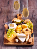 Many sorts of cheese with fruits. Over wooden board Royalty Free Stock Photos