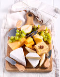 Many sorts of cheese with fruits. Over wooden board Stock Image