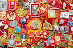 Many Soviet Union badges. Many Soviet Union (former Russia) badges on red banner Royalty Free Stock Photos