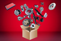Many spare parts flying out of the box Royalty Free Stock Photo