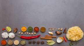 Many spices and herbs selection background. Stock Photos