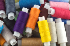 Colored spools with threads close up Stock Image