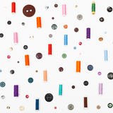 Many spools of sewing thread and various buttons Royalty Free Stock Images
