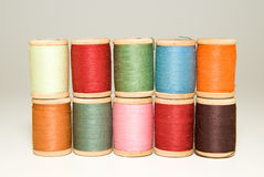 Many spools of thread of different colors on a white Stock Photography