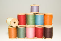 Many spools of thread of different colors on a white Royalty Free Stock Image