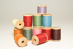 Many spools of thread of different colors on a white Stock Image