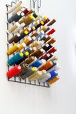 Many spools of thread hanging on the wall stock photography