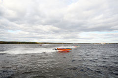 Many sportsmans fast float at motor boat on river Royalty Free Stock Image