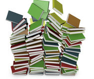 Many stacked colored books falling Royalty Free Stock Photography
