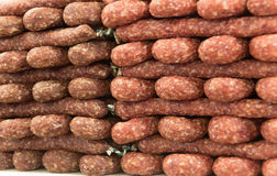 Many stacked dried sausages Royalty Free Stock Photo