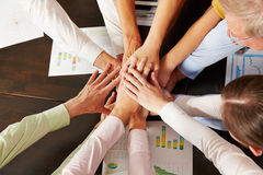 Many stacked hands from above. As symbol for cooperation in the office royalty free stock images
