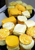 Many Stacks of Cheese. Many stacks of colorful cheese on two round serving trays stock photo