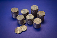 Many stacks of coins Stock Images