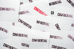 Many stamped confidential on white paper Royalty Free Stock Photos