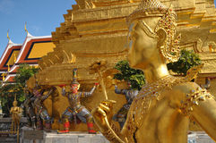 Many of the statues and figurines at Wat Phra Kaew or The Emerald Buddha in Bangkok, Thailand Royalty Free Stock Photo