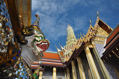 Many of the statues and figurines at Wat Phra Kaew or The Emerald Buddha in Bangkok, Thailand Stock Image