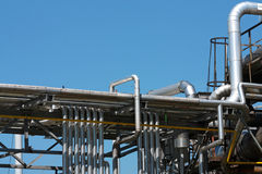 Many steel pipes in oil refinery royalty free stock photos