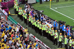 Many steward standing along the field Royalty Free Stock Images