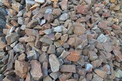 Many stones, Bulk of stones. Bulk of solid stones on the railways stock image