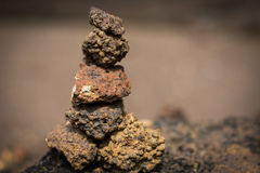 Many stones set vertical. Many brown stones set vertical stock photography