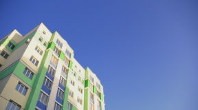 The many-storeyed house against the blue sky Stock Photo