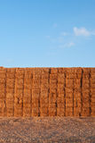 Many straw or hay bales stacked on a big pile Stock Images