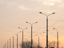 Many streetlights along the road Royalty Free Stock Image