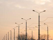Many streetlights along the road Royalty Free Stock Image