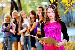 Many students in the autumn park Royalty Free Stock Photography