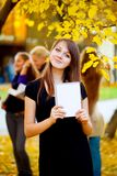 Many students in the autumn park Royalty Free Stock Image
