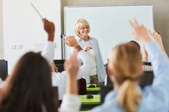 Many students in school lessons. Raising hands royalty free stock images