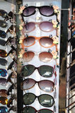 Many style of sun shades glasses on display. A photo taken on many ladies sun shade glasses on display. They comes in different design, colors and style Royalty Free Stock Image