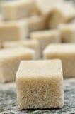 Many sugar brown cubes Stock Image