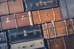 Many suitcases - old vintage suitcase stacked royalty free stock image