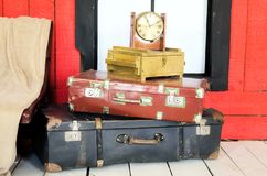 Many suitcases and watch. Many vintage suitcases and watch stock image