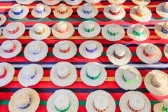 Many summer hats made of sisal ropes. As souvenirs royalty free stock photos