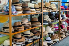 Many summer hats and Panama hats lie on the counter in the shop for tourists. Summer, Thailand. royalty free stock photo