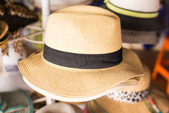 Many summer hats for sale at the market Stock Images