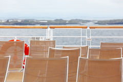 Many sun loungers are on deck of ship Royalty Free Stock Image