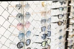 Free Many Sunglasses Rows At Optical Retail Store. Rich Assortment Choice Of Different Eyewear Frames On Eyeglasses Shop Display. UV Stock Photography - 151548322