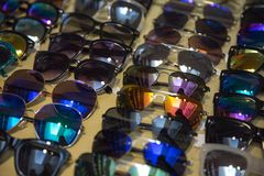 Many sunglasses on sale Royalty Free Stock Photo