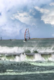 Many surfers windsurfing in a storm Stock Images