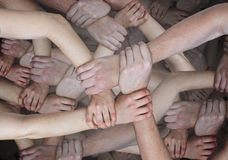 Many surreal holds holding each other. Community and teamwork concept. stock images