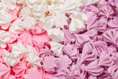 Many sweet biscuit meringue of different colors in box Royalty Free Stock Photo