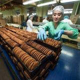 Many sweet cake food factory massive production Stock Photo