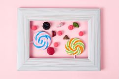Many sweet candy in white vintage photo frame. Stock Image