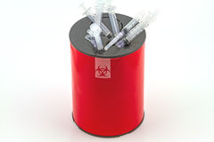 Many syringe in red disposal boxes on white background stock photos