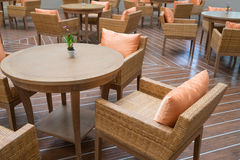 Many table with four chairs on wooden floor Royalty Free Stock Photos