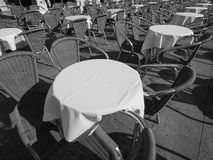 Many tables and chairs in black and white Stock Image
