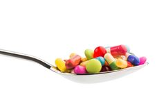 Many tablets on spoon Stock Photo